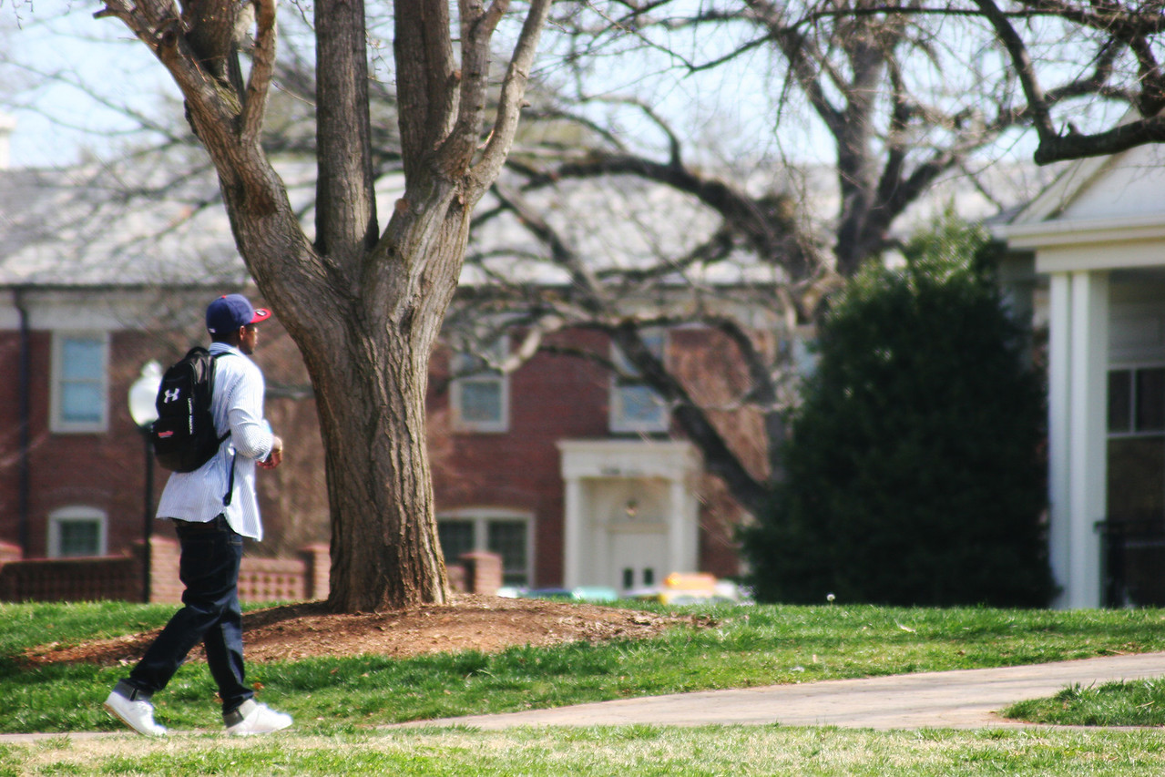 A Gardner-Webb University student walks toward class on a Spring day.