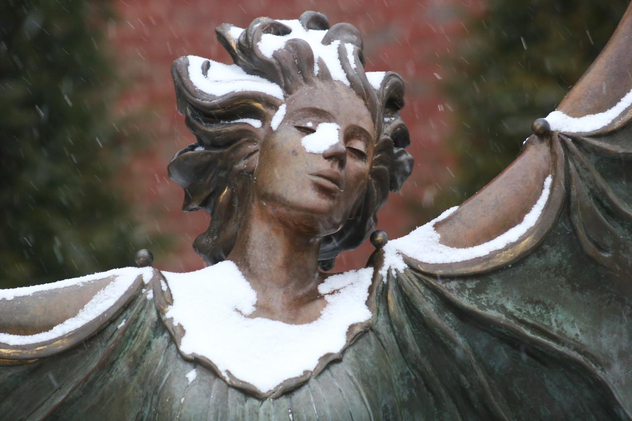 Snow falling on the Aurora statue near the Tucker Student Center on the campus of Gardner-Webb University.