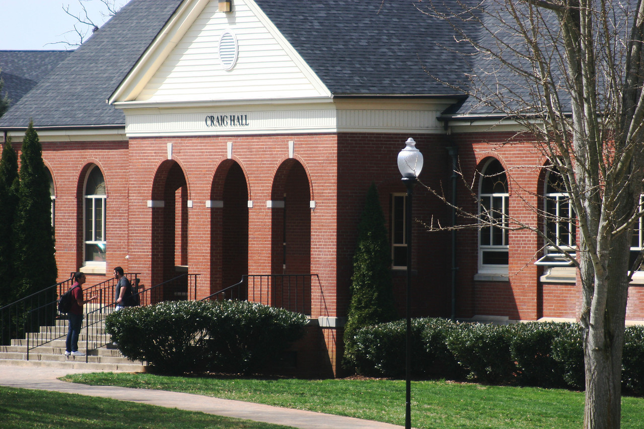 Two Gardner-Webb University students stand outside Craig Hall on a Spring afternoon.