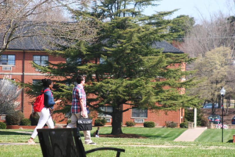 A Gardner-Webb University students walk toward class on a Spring day.