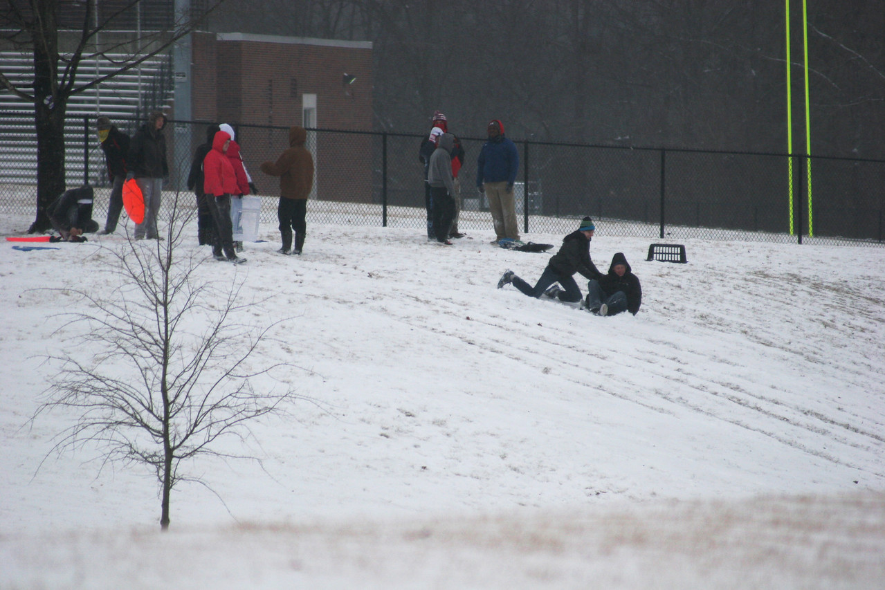 Students out sledding at the football field at Gardner-Webb University.