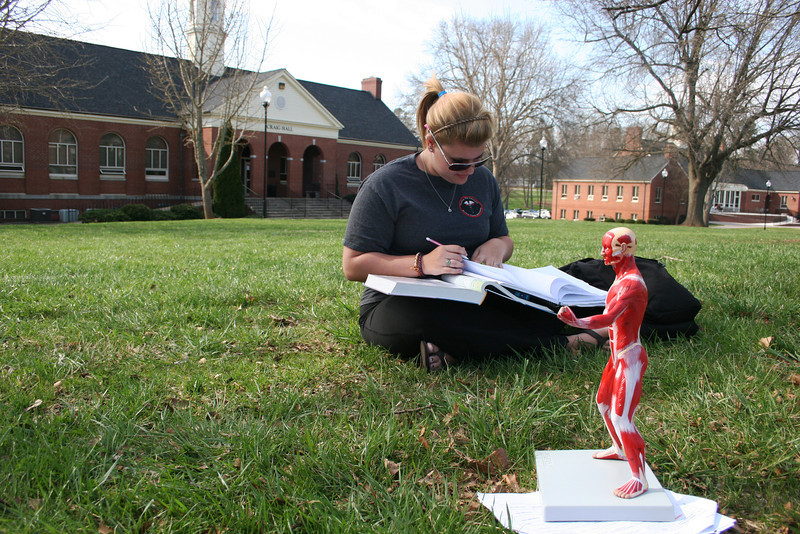A Gardner-Webb University student studies outside in the warm Spring afternoon.