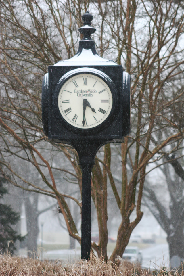 Snow covering the top of the clock near the Dover Campus Center on the campus of Gardner-Webb University.