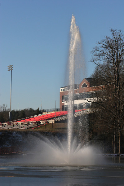 A frozen Lake Hollifield with the football stadium on the campus of Gardner-Webb University.