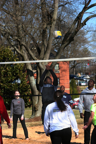 Gardner-Webb University students playing volleyball.