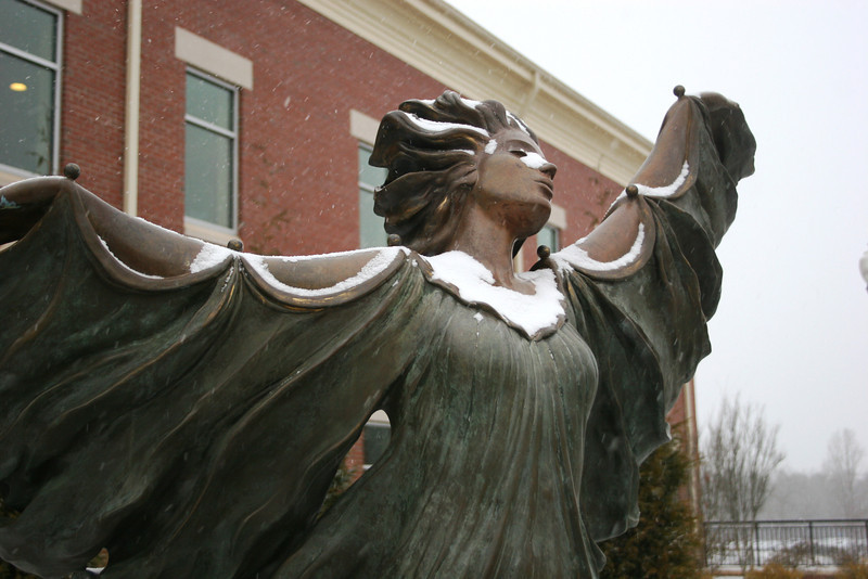Snow falling on the Aurora statue near the Tucker Student Center on the campus of Gardner-Webb University.
