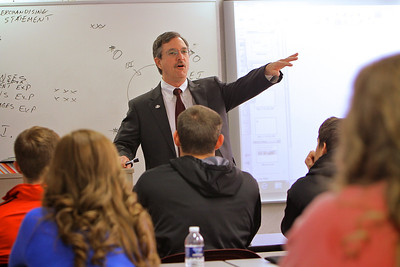 Earl Godfrey instructing an accounting class. Spring 2014