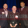 Alumni Matt Houston, honoree Hoang Dand and sponsor Kevin Davis from TCU's Neeley School of Business.