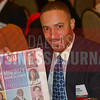 Honree Jesse Crawdord shows off the DBJ's Minority Business Leader Awards publication.