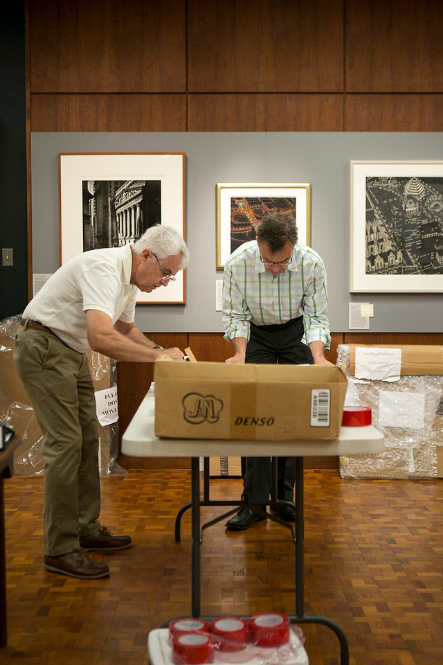 Joanne Payson aids in the deinstallation process of A Century of Self-Expression at Bryn Mawr College.