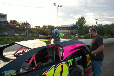#19 Shaun Warner prepares Asher for a ride around the track.