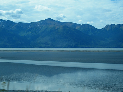 Driving southeast out of Anchorage along the Turnagain Arm of Prince William Sound. Kenai Peninsula across the water.