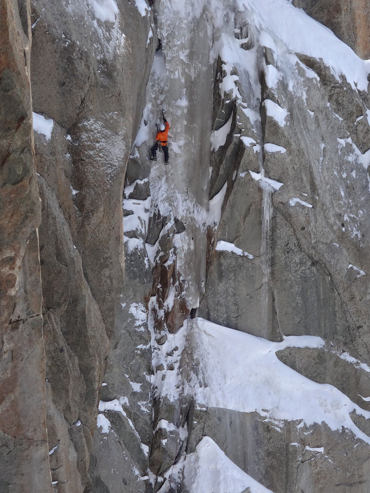 Others tried harder routes. 3 of these guys formed a 100 m vertical line. This guy was leading. It was mixed vertical ice and rock the whole way, and beyond, if they fell...