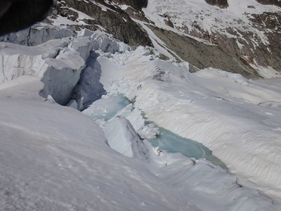 These ice lakes on the glacier near the crevasses provided a perfect water source for the yeti - and possibly a bathing area as well. But still, it seemed I would have to enter the crevasses to encounter the yeti, and my courage was not at its best this day...