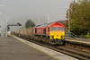 30 April 2014 :: With the spring sunshine in the process of burning off the morning fog, 59203 is seen passing through Basingstoke Station working 6O12 stone train from Merehead to Woking