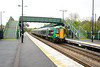 "23 April 2014 :: 172336 is seen passing under the ""Barnetby"" style footbridge at Stratford-upon-Avon Parkway with 2W82 the 1503 Stratford-upon-Avon to Stoubridge Junction"
