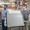 140418 GM JOED VIERA/STAFF PHOTOGRAPHER-Lockport, NY-GM team leaders <br /> Christopher Harper and Chris Pilarski show off a finished heavey duty radiator unit at the General Motors Harrison Radiator Division plant April 9, 2014.
