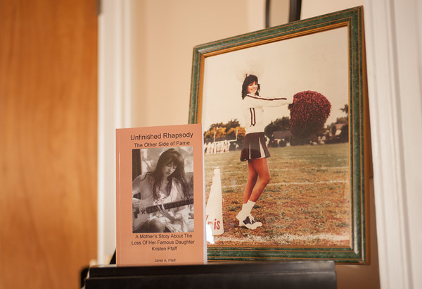 "140326 Lockport Author JOED VIERA/STAFF PHOTOGRAPHER-Lockport, NY- A copy of ""Unfinished Rhapsody""  and portrait of Kristen Pfaff stand on a piano at Janet Pfaff's home on Mar.26, 2014. on Mar.26, 2014."