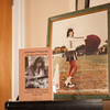 """140326 Lockport Author JOED VIERA/STAFF PHOTOGRAPHER-Lockport, NY- A copy of """"Unfinished Rhapsody""""  and portrait of Kristen Pfaff stand on a piano at Janet Pfaff's home on Mar.26, 2014. on Mar.26, 2014."""