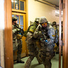 140416 Sheriff training JOED VIERA/STAFF PHOTOGRAPHER-Lockport, NY-A Sheriff deputy surveys a room at Desales Catholic School during a training exercise April 16, 2014.