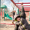 140325 Youth Bureau JOED VIERA/STAFF PHOTOGRAPHER-Lockport, NY-Chanler Monroe swings on the playground in front of the Youth Bureau on Mar.16, 2014.