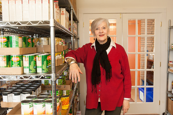 142408 Wilson Pantry JOED VIERA/STAFF PHOTOGRAPHER-Wilson, NY- Janet Hoffman stands by a shelve at the Wilson Community Food Pantry April 8, 2014.