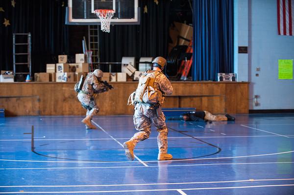 140416 Sheriff training JOED VIERA/STAFF PHOTOGRAPHER-Lockport, NY-Sheriff deputies apprehend a suspect during a training exercise at Desales Catholic School April 16, 2014.