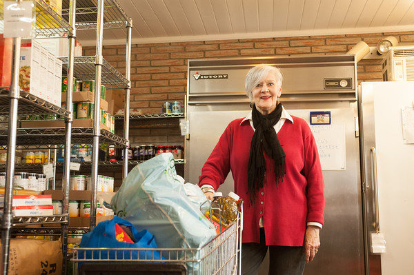 142408 Wilson Pantry JOED VIERA/STAFF PHOTOGRAPHER-Wilson, NY- Janet Hoffman stands by a full shopping cart at the Wilson Community Food Pantry April 8, 2014.