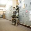 140416 Sheriff training JOED VIERA/STAFF PHOTOGRAPHER-Lockport, NY-Sheriff deputies  guard a hallway during a training exercise at Desales Catholic School April 16, 2014.