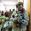 140416 Sheriff training JOED VIERA/STAFF PHOTOGRAPHER-Lockport, NY-A Sheriff deputy looks out for more shooters as a wounded Firefighter is treated at Desales Catholic School during a training exercise April 16, 2014.