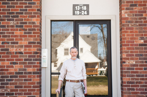 142409 Bertrand JOED VIERA/STAFF PHOTOGRAPHER-Lockport, NY-Richard Bertrand stands in front of his apartment April 9, 2014.