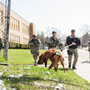140416 Sheriff training JOED VIERA/STAFF PHOTOGRAPHER-Lockport, NY-Sheriff deputies and a K9 unit carry out a search for a shooter at large outside of Desales Catholic School during a training exercise April 16, 2014.