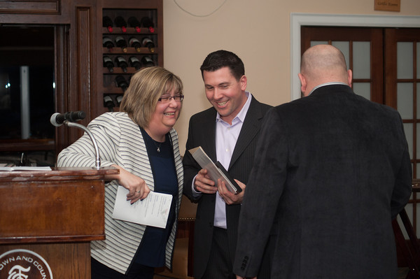 140326 LBA JOED VIERA/STAFF PHOTOGRAPHER-Lockport, NY-Marie Walters laughs with Erik Bernardi  and Jason Wulf after they accepted the Lockport business of the year award at the Lockport Country Club Mar.27, 2014.