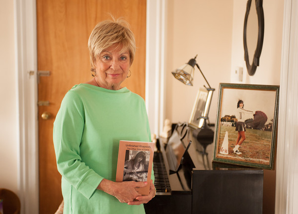 "140326 Lockport Author JOED VIERA/STAFF PHOTOGRAPHER-Lockport, NY- Janet Pfaff holds her book ""Unfinished Rhapsody""  in her home on Mar.26, 2014."
