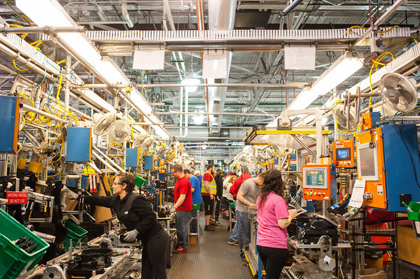 140418 GM JOED VIERA/STAFF PHOTOGRAPHER-Lockport, NY-A GM team assembles HVAC units for trucks at the General Motors Harrison Radiator Division plant April 9, 2014.
