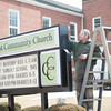 140402 3A Ent JOED VIERA/STAFF PHOTOGRAPHER-Lockport, NY-Ken Kirkpatrick paints the Christ Community Church sign on Pine St. Mar. 31, 2014.