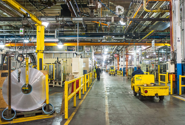 140418 GM JOED VIERA/STAFF PHOTOGRAPHER-Lockport, NY-Workers move parts around the General Motors Harrison Radiator Division plant April 9, 2014.