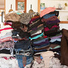 142409 Celebration show JOED VIERA/STAFF PHOTOGRAPHER-Lockport, NY-A stack of clothes Peggy Shea-Robichaud intends to donate lay on her couch April 9, 2014.