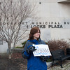 140415 Gia JOED VIERA/STAFF PHOTOGRAPHER-Lockport, NY-Mattie Zarpentine holds a sign in support of Gia Arnold in front of One Locks Plaza April 15, 2014.