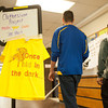 142408 Clothesline JOED VIERA/STAFF PHOTOGRAPHER-Sanborn, NY- Students pass a t-shirt and sign welcoming them to make t-shirts at NCCC April 8, 2014.