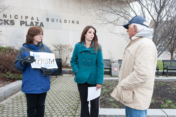 140415 Gia JOED VIERA/STAFF PHOTOGRAPHER-Lockport, NY-Mattie Zarpentine holds a sign in support of Gia Arnold as the candidate speaks to Dick Bridwell in front of One Locks Plaza April 15, 2014.