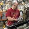 140418 GM JOED VIERA/STAFF PHOTOGRAPHER-Lockport, NY-Richard Benevento assembles a GM radiator at the General Motors Harrison Radiator Division plant April 9, 2014.
