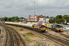 28 August 2013 :: 66059 is passing Millbrook with train 6B94 from Fawley to Eastleigh alongside 66418 in the Freightliner yard