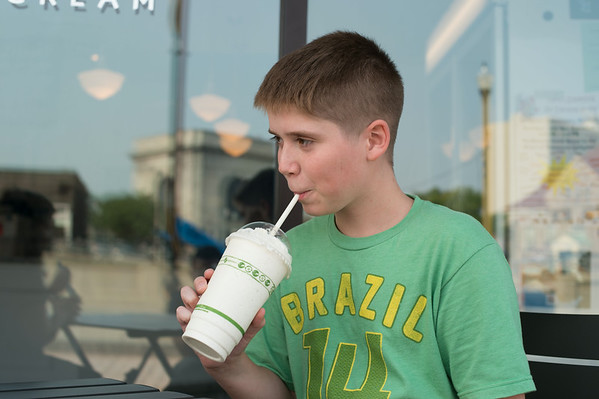 140807 JOED VIERA/STAFF PHOTOGRAPHER-Lockport, NY-Carson Tiede enjoys a milkshake outside of Lake Effect Ice Cream on Thursday, August 7th.