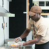 JOED VIERA/STAFF PHOTOGRAPHER-Lockport, NY- Anthony Person owner of the new Big Boss BBQ food truck makes the truck's staple Slawwich on Wednesday, August 20th.