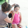 140801 JOED VIERA/STAFF PHOTOGRAPHER-Lockport, NY-Lyn Martone paints Natalie Ramos 7 at the Niagara County Fair on Friday, August 1st.