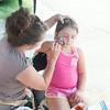 140801 JOED VIERA/STAFF PHOTOGRAPHER-Lockport, NY-Lyn Martone paints Natalie Ramos 7 at the Niagara County Fair on Friday, August 1st.