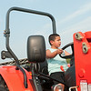 140801 JOED VIERA/STAFF PHOTOGRAPHER-Lockport, NY- Wesley Montpleasant rides a tractor at the Niagara County Fair on Friday, August 1st.
