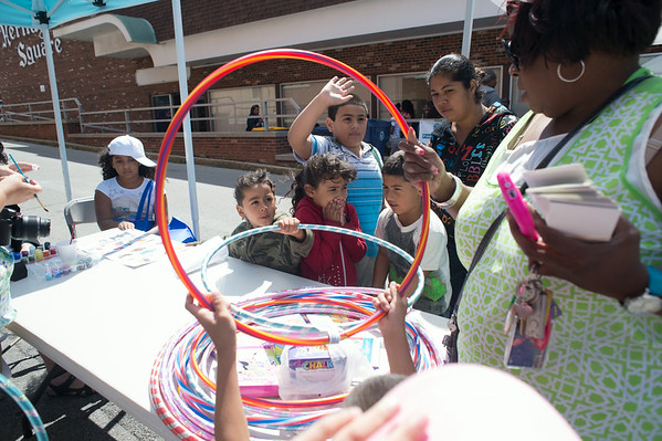JOED VIERA/STAFF PHOTOGRAPHER-Lockport, NY- Kids pick up hoola hoops for a contest at the Health Fair on Thursday, August 14th.