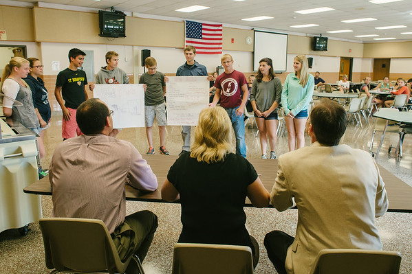 """JOED VIERA/STAFF PHOTOGRAPHER-Lockport, NY- Judges Brad Pritchard, Barbara Converso and Roger Klatt watch as a group of students present thier product """"Bed Buds"""" during the Academy of Finance at Barker High School on Tuesday, August 12th."""